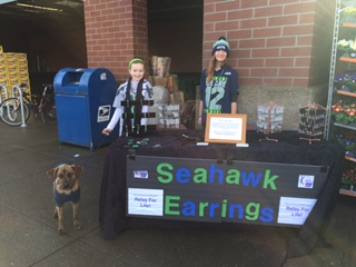 These two young girls raised over $1000 selling Seattle Seahawks earrings and necklaces!