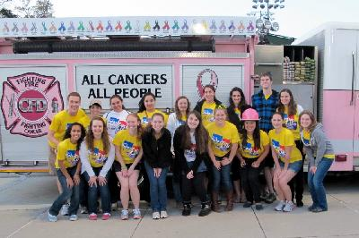 Colleges Against Cancer poses with the Relay firetruck at Relay for Life 2012!